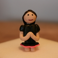 Girl Praying  Made this statue from Gumpaste for a confirmation cake. The black was airbrushed the rest was colored paste. Got the idea from a video on...