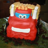 Chuck The Truck Tonka truck Chuck. 2 square cakes, cut out the shape of the truck and covered with fondant. This is my first 3D cake attempt.