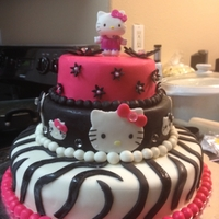 Hello Kitty   All decorations are fondant, cake is strawberry with buttercream frosting