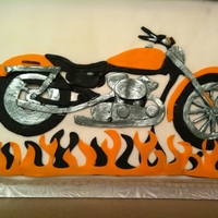 "Motorcycle Sheet cake covered in fondant.Fondant was cut out and pieced together, then chrome pieces were ""painted"" with silver."