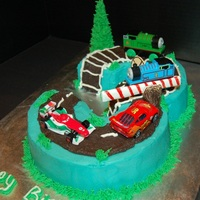 Thomas Meets Lightning Mcqueen This is for my son's 3rd birthday today. Thanks to mandirombold for her help in determining how to cut the cakes to get the shape for...