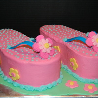 Summertime Flip Flop Cake Chocolate and vanilla marble cake with vanilla BC. Flowers and straps are gumpaste.