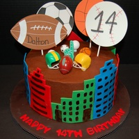 Sports And Big City City buildings are fondant with a little tylose power. The pieces on top are plastic picks and foam pieces attached to lollipop sticks. I...