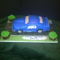 69 Mustang Mach 1 My first car cake. Lots of detail but worth the effort. Fondant strips around the windows and trim then painted with silver pearl dust....