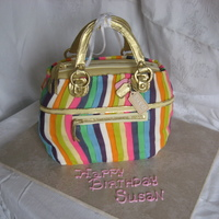 "Purse Cake A replica of a Coach purse. 9 colors of fondant in 1/2"" strips. Thank you to Craftsy for the classes for help in learning different..."