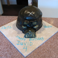 Darth Vador 3 1/2 cakes with both regular and cho/peanut butter buttercream covered in chocolate fondant. 1/2 of the cake was yellow and 1/2 was...