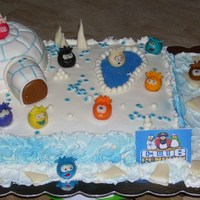 Club Penguin Cake Club Penguin Cake for my niece. 9x13 chocolate cake with rkt igloo, frosted and covered in mmf. The little round faces are called puffles....