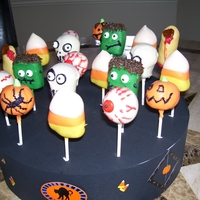Halloween Cake Pops These are my first attempts at cake pops. I made these with a pumpkin cake and my husband couldn't stay out of them.