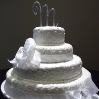 Mccosh Wedding Cake 4 tier lace design cake