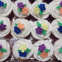 Floral Cupcakes Cupcakes with apple blossoms and leaves.