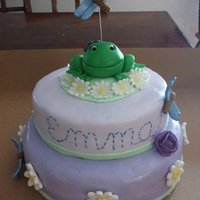 Baby Shower Cake W/ Frog And Daisy Detail 2 teired purple fondant cake, with fondant frogs, daisies and dragonflies.
