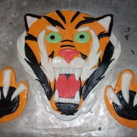 Fondant Tiger This is the tiger I made for a graduation cake (Didn't get a finished project pic). I just used different colored fondant and over...