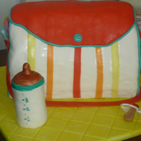 Diaper Bag Cake My first carved cake! This was for a baby shower where the sex of the baby was unknown, but the mother-to-be wanted bright colors. The...