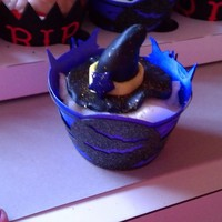 Witch's Hat Cupcakes These toppers are made of fondant. I also made the wrapper in a witch themed background.