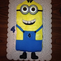 Minion From Despicable Me This is a cupcake cake of a minion using both buttercream and fondant.