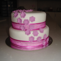 Nans Birthday Cake Sponge cake covered in fondant. Only a small 2 tier. My first two tier actually.
