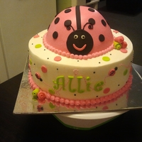 Lady Bug Lady Bug birthday cake iced in buttercream decorated with fondant accents.