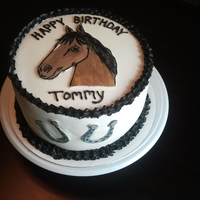 Horse Round 3 layer cake covered with buttercream with hand painted fondant horse.