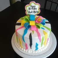 Colorful Zebra Print Colorful Zebra Print cake with fondant bow.