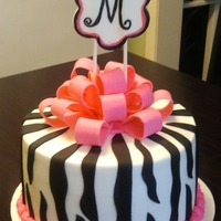 Zebra Print Zebra Print cake with pink border and pink gumpaste bow.