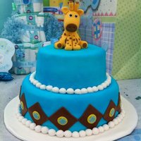 Giraffe Baby Shower Cake This is a chocolate cake with strawberry filling covered in fondant. All decorations are fondant and giraffe is gumpaste.