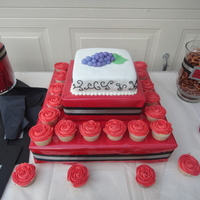 Vineyard Theme Cake With Red Rose Cupcakes This is a chocolate cake with cream cheese filling covered in fondant. Cupcakes are white cake with buttercream.