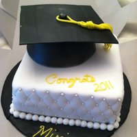 Graduation Cake This cake was chocolate with cream cheese covered in fondant. Hat made out of a half of wilton ball pan and the mortar is gumpaste left to...