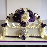 Royal Iced, With Sugarpaste Roses, Purple, Ivory This was my first ever wedding cake, Its friut, royal iced with royal piping and corners, with sugarpaste roses and leaves. It reached it...