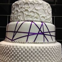Dots, Scrols, Purple. This was my First Fondant covered wedding cake.