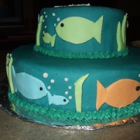 "Mommy Fish, Baby Fish Shower Cake The second fondant cake I ever made. Got the colors from the shower invitation, and my husband came up with the ""mommy/baby"" idea..."
