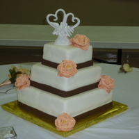 My First Wedding Cake! Square, three-tier, WASC cake filled with vanilla American buttercream and covered with ivory fondant. Chocolate fondant ribbons around the...