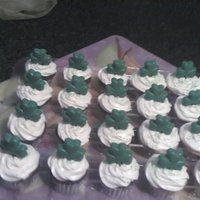 Shamrock Cupcakes Yellow and chocolate cupcakes with cream cheese frosting and edible chocolate shamrocks
