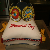 Memorial Day Pillow Cake With Seals Topper   A cushiony pillow cake in fondant with buttercream details and all 5 military seals in gum paste and royal icing.