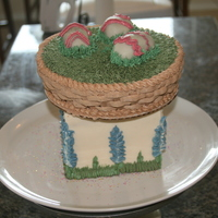 Texas Bluebonnet Easter Egg Cake   A simple Easter basket with three cakeball eggs on top of a bluebonnet pedestal. 100% buttercream and piping, no fondant.