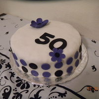 Happy 50Th Birthday I made this cake for my moms 50th Surprise Party. Purple & Black Polka Dots, 50, Purple flower, MMF Fondant