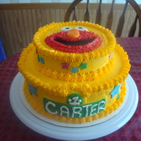 Elmo 1St Birthday Cake   White chocolate & strawberry swirl cake frosted with white chocolate butter cream.