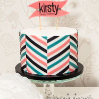 Offset Chevron Birthday Cake A birthday cake covered with an offset chevron design as made famous by Jessicakes. The inside of the cake is a coconut sponge cake filled...