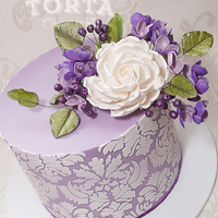 Purple Damask Birthday Cake A very purple surprise cake! Sugar flowers and foliage and some cute purple berries. A zesty lime sponge filled with lemon curd swiss...