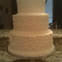 Three Tier With Scrolls All three tiers were white cake with white buttercream.