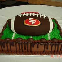 49Er's Groom's Cake Chocolate cake with chocolate ganache. Football covered in chocolate fondant and decorated with SF 49er's.