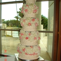 Tall Tier Wedding Cake This cake was about 7-1/2 feet tall from floor to the top (includes table). The flowers were added by the mother of the bride. I used the...