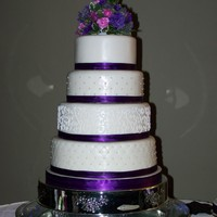 Purple & White Stacked Fondant Wedding Cake  This is a fondant covered with 3 patterns - each tier a different flavor; white, Italian Cream, chocolate and the companion cake is gluten-...