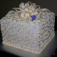 "Baby Shower ""gift""  This is a white tie cake (chocolate, white, chocolate) covered in lavender fondant with cream piping and bow to match the nursery of the..."