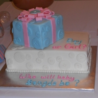 Gender Reveal Cake   Vanilla cake with vanilla butter cream and mmf. All buttons and the bow are made from mmf.