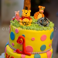 Winnie The Pooh & Friends Themed Birthday Cake 8 and 10 inch, chocolate devils food cake rounds, covered with Fondx fondant. All decorations and characters hand made with gumpaste and...