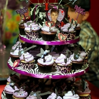 Justin Bieber Justin Bieber cupcake tower. Vanilla and Devil's food cake with fondant decorations. Whipped topping for the icing. TFL!