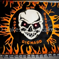 Skull And Flames Biker Cake Devils food sheet cake. Iced and filled in vanilla buttercream. Cake was covered in Satin Ice black fondant. All decorations handmade out...