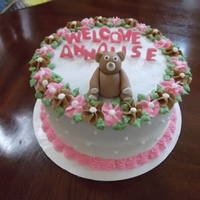 Small Baby Girl Shower Cake Small cake in vanilla buttercream with drop flowers and fondant teddybear.