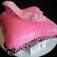 1322275321.jpg Pink high heel shoe made out of gumpaste on a pillow shaped cake covered in fondant. Cake is white velvet with cream cheese filling. Made...