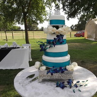 "1315777071.jpg Teal 4 tier wedding cake. 12"" marble with chocolate custard, 10"" and 8"" white velvet with fresh strawberries and 6"" is..."